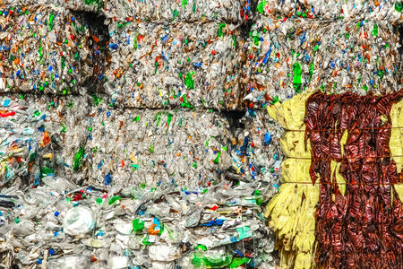 waste products: Square bales of wrapped plastic bottles ready for the melting process. Stock Photo
