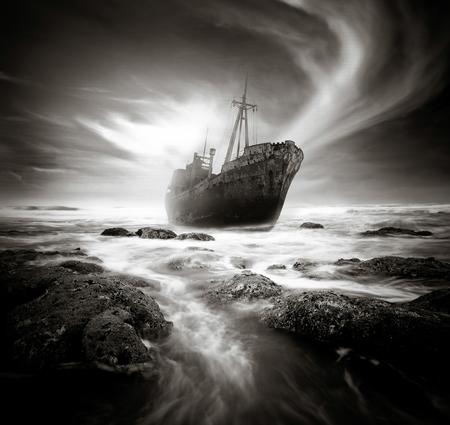 rocky coastline: Shipwreck along a rough and rocky coastline.