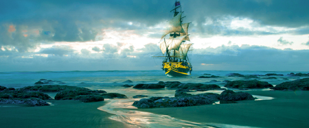 merchant: A merchant marine sail ship sailing dangerously close to rocks and the beach.