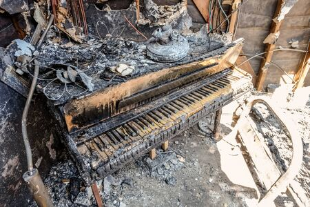 single family home: Fire and smoke damaged furniture in a single family home.
