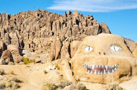 alabama hills: Hand painted monster face on a rock in the Alabama Hills of California. Stock Photo