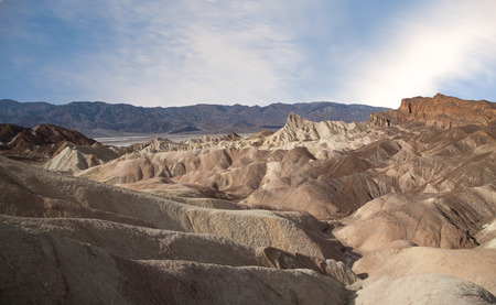 noted: Zabriskie Point is a part of Amargosa Range located east of Death Valley in Death Valley National Park in California, United States noted for its erosional landscape. Stock Photo