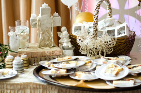 baptismal: Cake on small plates sitting atop a childs baptismal gift table.