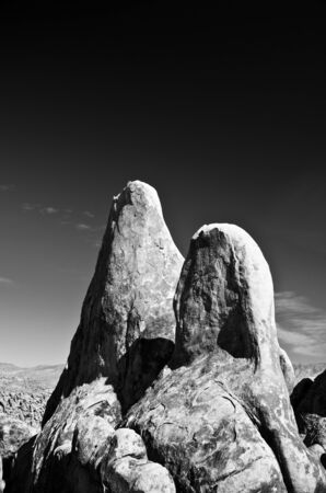 The Alabama Hills are a range of hills and rock formations near the eastern slope of the Sierra Nevada in the Owens Valley, west of Lone Pine in Inyo County, California, United States. Stock Photo