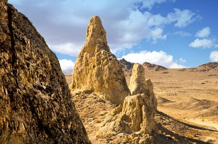 geological feature: The Trona Pinnacles are an unusual geological feature in the California Desert National Conservation Area. The unusual landscape consists of more than 500 tufa spires, some as high as 140 feet, rising from the bed of the Searles Lake basin. Stock Photo