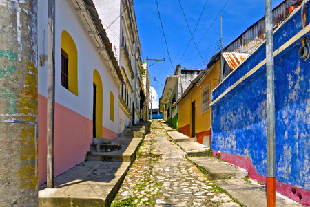 This is the very colorful Flores Street in Antigua, Guatemala