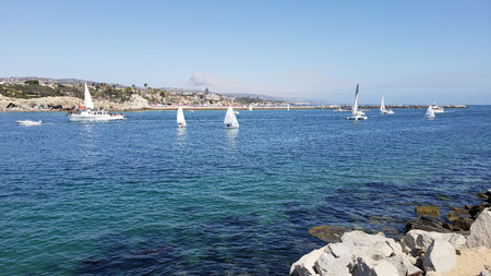 Corona Del Mar and Newport Harbor entry with sail and motor boats. Imagens