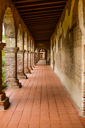 Red brick hallway decorating an old monastery. Imagens