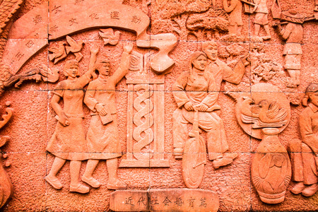 hard times: wall relief sculpture