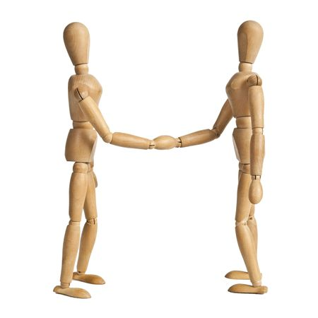 The businesspeople shaking hands, making an agreement.