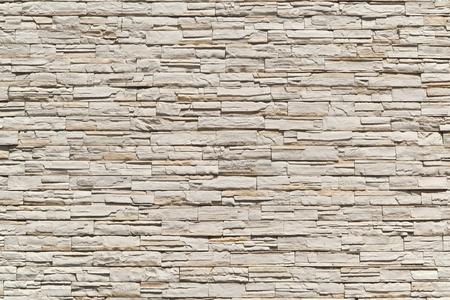 yellow stone: Muro de ladrillo la moderno Foto de archivo