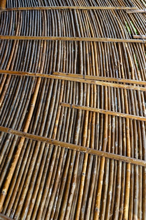 Closed up of brown bamboo, detail from the floor as background.  photo