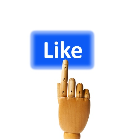Wooden finger pressing a like button. Stock Photo - 9945170