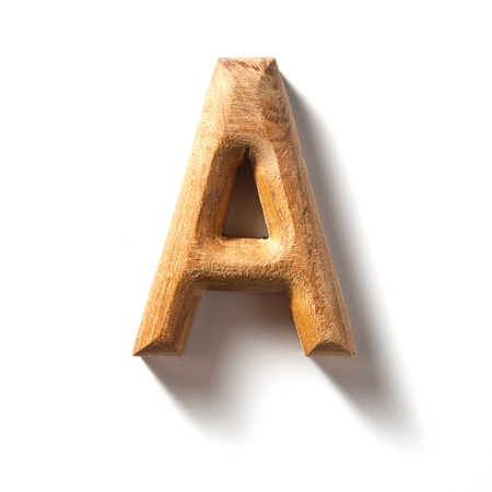 old writing: Wooden alphabet letter with drop shadow on white background, A