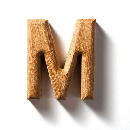 old letters: Wooden alphabet letter with drop shadow on white background, M