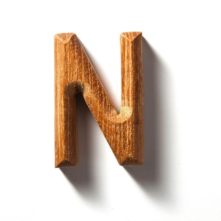 letter n: Wooden alphabet letter with drop shadow on white background, N