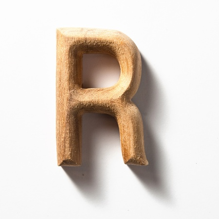 letter r: Wooden alphabet letter with drop shadow on white background, R