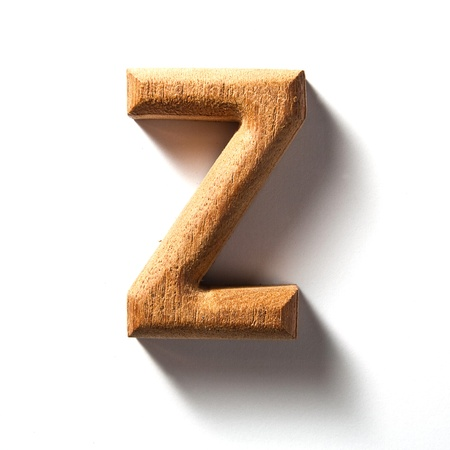 Wooden alphabet letter with drop shadow on white background, Z Stock Photo - 10036603