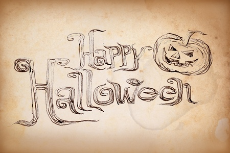 Hand writing Halloween on old paper photo