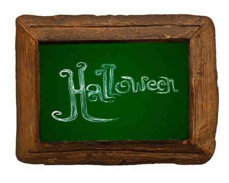Hand writing Halloween on green board with wooden frame photo