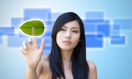 Portrait of Asian girl press recycle button, creative concept of ecological Stock Photo
