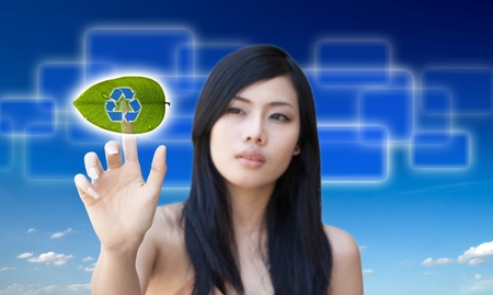 Portrait of Asian girl press recycle button, creative concept of ecological photo