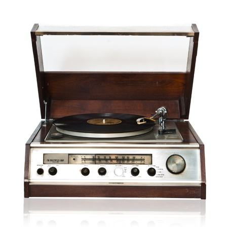 Vintage record player with radio tunner isolated on white background photo