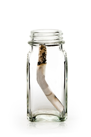 Cigarette in bottle photo