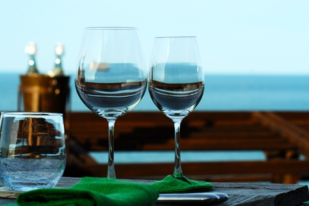 Two of glasses over the sea in the evening