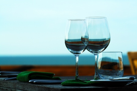 Two of glasses over the sea in the evening photo