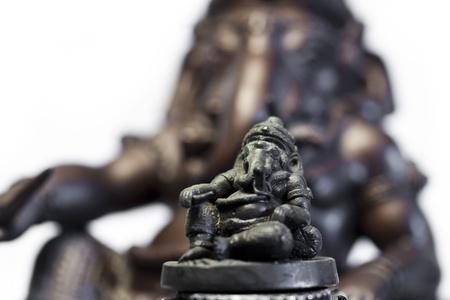 destroyer: The mini Hindu God Ganesha over a big Hindu God Ganesha in background