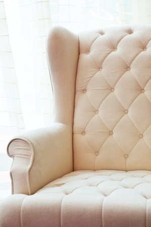 furniture detail: The white luxury armchair isolated on white background