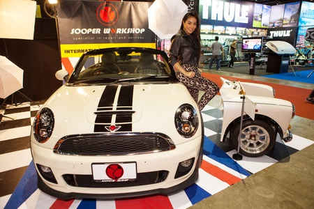 modell: NONTHABURI THAILAND-JUNE 20 : Unidentified of Modell post over Mini displayed at Bangkok International Auto Salon 2013 on June 30, 2013. The event exiting modified car showed in Nonthaburi, Thailand.