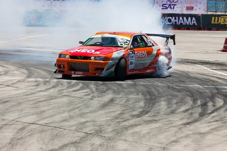 d1: NONTHABURI THAILAND-JUNE 30 : T. Banjongaksorn, Thai driver from Eneos Injection Drift Team in D1 Grand Prix Series Thailand Professional Drift on June 30, 2013  in Nonthaburi, Thailand. Editorial