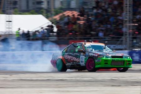 d1: NONTHABURI THAILAND-JUNE 30 : T. Thongchue, Thai driver from Ptt Performa Drift Team in D1 Grand Prix Series Thailand Professional Drift on June 30, 2013  in Nonthaburi, Thailand. Editorial