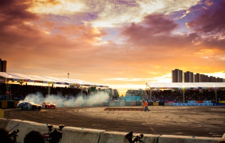 NONTHABURI THAILAND-JUNE 30 : Wide angle view of drifting track with beautiful twiligt sky as background in D1 Grand Prix Series Thailand Professional Drift on June 30, 2013 in Nonthaburi, Thailand. Stock Photo - 24675390