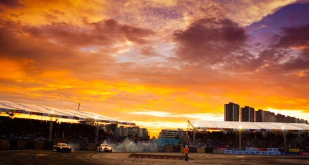 NONTHABURI THAILAND-JUNE 30 : Wide angle view of drifting track with beautiful twiligt sky as background in D1 Grand Prix Series Thailand Professional Drift on June 30, 2013 in Nonthaburi, Thailand. Stock Photo - 24675391