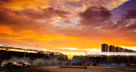 d1: NONTHABURI THAILAND-JUNE 30 : Wide angle view of drifting track with beautiful twiligt sky as background in D1 Grand Prix Series Thailand Professional Drift on June 30, 2013 in Nonthaburi, Thailand. Editorial