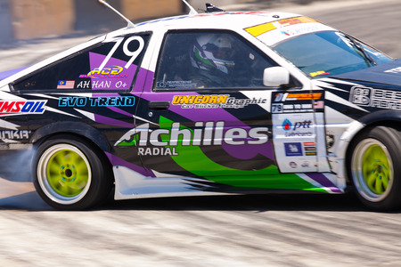 d1: NONTHABURI THAILAND-JUNE 30 : Ong Yo Han, Malaysian driver from Achilles AVS Drift Team in D1 Grand Prix Serise Thailand Professional Drift on June 30, 2013  in Nonthaburi,Thailand. Editorial