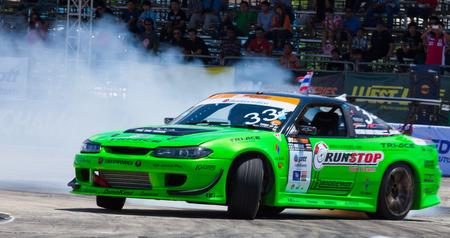 d1: NONTHABURI THAILAND-JUNE 30 : W. Sonthilawatch, Thai driver from Run-Stop Tire-Ace Team  in D1 Grand Prix Series Thailand Professional Drift on June 30, 2013  in Nonthaburi, Thailand.