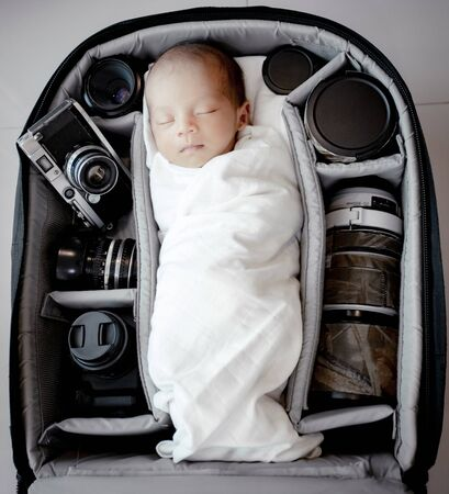 Set up baby newborn in the bag of photography with accessory photograph.