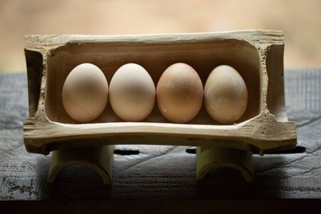 A tray made of bamboo with fresh eggs from the farm.