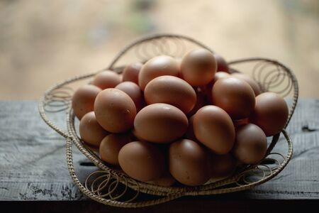 A basket with fresh eggs from the farm.
