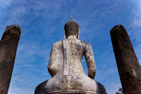 Behind the Buddha statue. Sukhothai Historical Park.