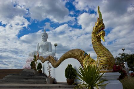 Buddha and the serpent in the blue sky above. photo