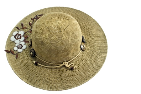 top view of straw hat on white photo