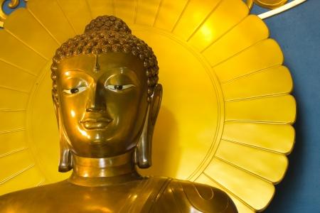 statuary: Golden Buddha statue  Stock Photo