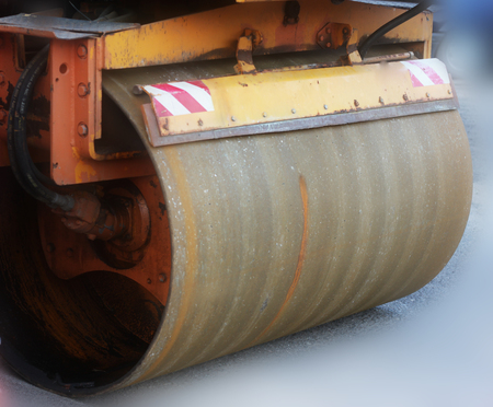 vibroroller: Large view on the road rollers working on the new road construction site Stock Photo