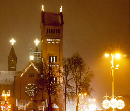 Minsk, Republic of Belarus on December 21, 2017, the time is 21:30. Very heavy snow, cork. Evening Minsk on the eve of the new year, the church is in the central square, very soft focus