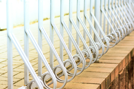 beautiful forged fence. beautiful fence with artistic forging, close-up. Stock Photo